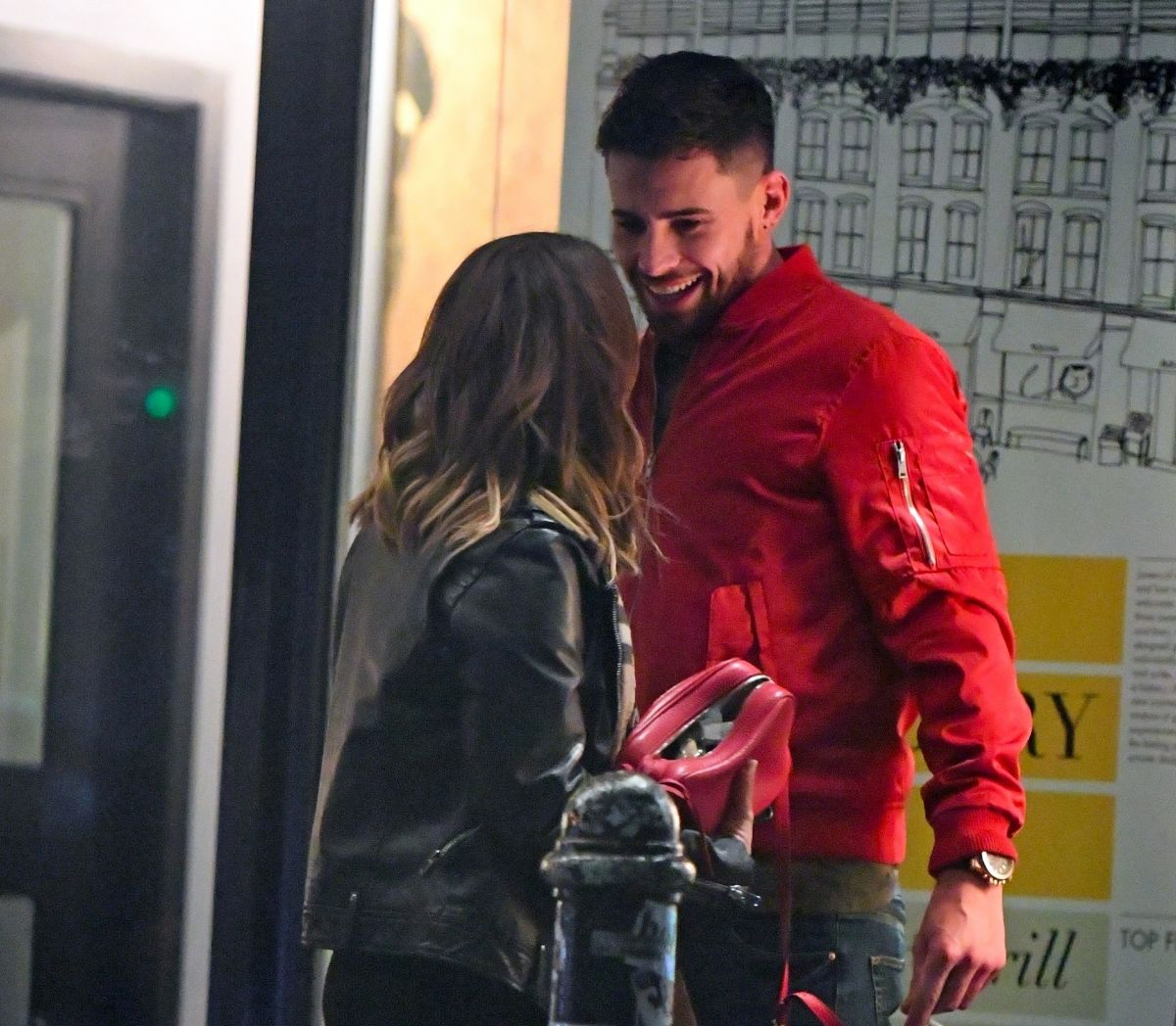 Caroline Flack and Andrew Brady looking loved up cuddling ...