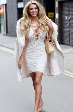 Christine McGuinness Pictured looking stunning in white dress - Manchester