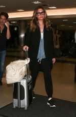 Daisy Fuentes and Richard Marx are seen arriving on a flight at LAX airport in Los Angeles
