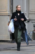 Elizabeth Berkley Out for shopping at Louis Vuitton in New York City