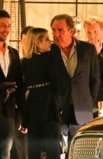 Emma Roberts and Oliver Stone are spotted as they have a chat after the CAA pre Oscar party in West Hollywood