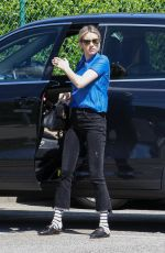Emma Roberts Wearing a Blue Blouse while out and about in Beverly Hills