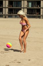 Frenchy Morgan Takes advantage the first warm Southern California day in a month to go to Malibu Beach