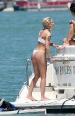 Halsey In a white bikini as she relaxes with Josie Canseco on a yacht in Miami