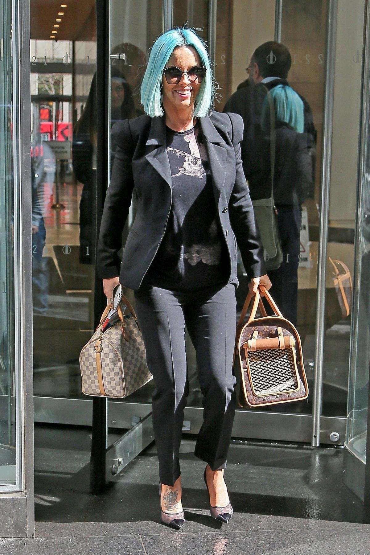 6f3616e26954 Jenny McCarthy Seen carrying her TWO Louis Vuitton bags while leaving work in  New York City