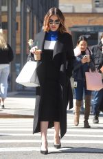Lucy Hale Sips on Starbucks ice coffee while out in SoHo