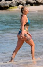 Olivia Buckland and Alex Bowen pictured on beach in Barbados