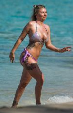 Olivia Buckland Takes a quick dip in the ocean on the beach in Barbados