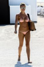 Samantha Hoopes In pink bikini as she soaked up the morning sun on the beach in Miami