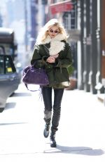Elsa Hosk Leaving the gym while on her phone in New York City