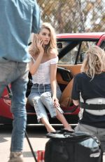Elsa Hosk Posing behind the wheel of a classic ferrari during a photoshoot in Miami