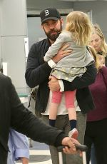 Emily Blunt & John Krasinski At JFK Airport in New York