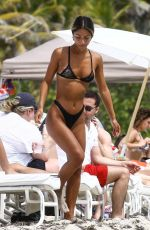 Erika Wheaton Looks great in a bikini on the beach in Miami