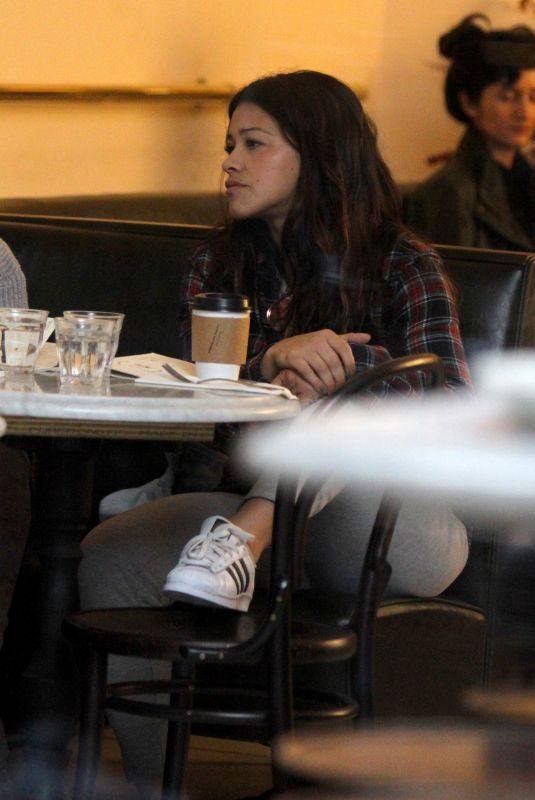 Gina Rodriguez and Brittany Snow pictured having breakfast during scene at the Someone Great set in the West Village, Manhattan