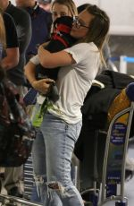 Hilary Duff Spotted with her puppy at LAX Airport in LA