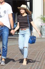 Joey King Holds hands with Jacob Elordi while shopping at The Grove in LA