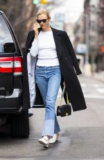 Karlie Kloss Defines street style as she arrives home from London to NYC