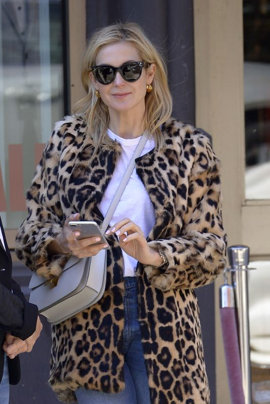 Kelly Rutherford Seen wearing a leopard fur coat and denim pants after having lunch at Cipriani