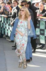 Kylie Minogue Poses for pictures outside of AOL Build in New York