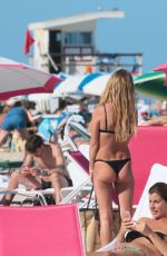 Madison Louch In a black bikini at the beach in Miami