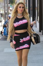 Marcela Iglesias Turns heads in a Moschino skirt and matching crop top while shopping in Beverly Hills
