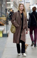 Martha Hunt Takes her dog out for a walk in NYC