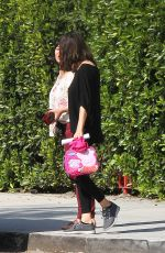 Mila Kunis Chatting to a lady on the street while out in the early morning in LA