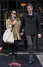 Milla Jovovich Holds hands with husband Paul W. S. Anderson while exiting the Bowery Hotel in New York City