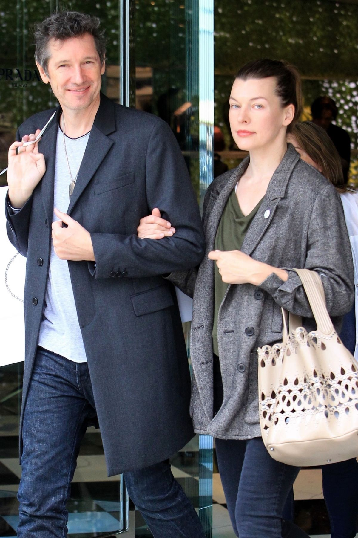 Milla Jovovich with her husband Paul W. S. Anderson shopping as they leave the Prada store in Beverly Hills