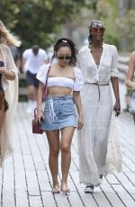 Models Toni Garrn, Ubah Hassan and Alina Baikova stroll along the boardwalk on their way for lunch in Miami Beach