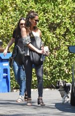 Olivia Munn Carrying her dog around her chest in a dog pouch as she goes for a morning walk in Los Angeles