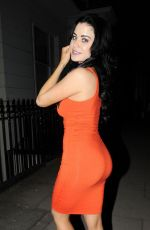 Carla Howe In orange dress while pictured enjoying a night out on Bank Holiday monday in London