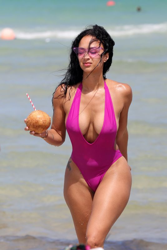Draya Michele In a pink swimsuit and bikini poolside in Miami