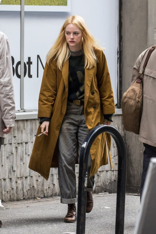 Emma Stone Filming a scene looking at junk on the Maniac set on Park Avenue in New York