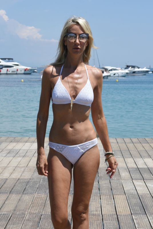 Lady Victoria Hervey In a White Bikini relaxing at a hotel in Antibes