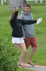 Lucy Hale and Riley Smith are seen smiling while out for a stroll along the beach in Maui