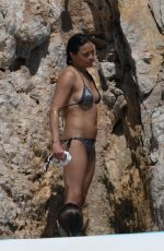 Michelle Rodriguez by the swimming pool at Hotel Du Cap Eden Roc in Antibes