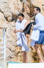 Michelle Rodriguez In bikini as she takes a shower outside at the pool at the Cap Eden Roc hotel in Antibes