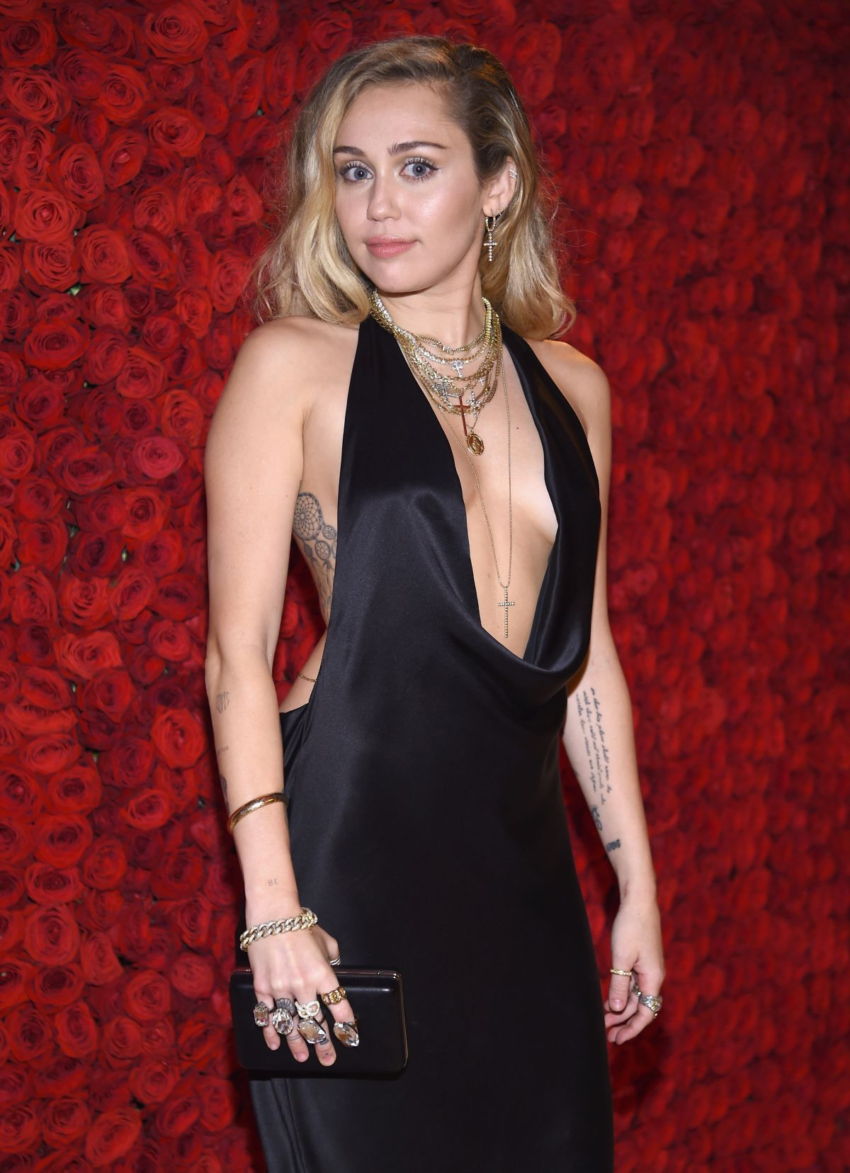 3568c7f140b Miley Cyrus At Heavenly Bodies  Fashion   The Catholic Imagination Costume  Institute Gala – Cocktails