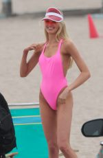 Romee Strijd In a pink bathing suit while posing on the beach for a photoshoot in Malibu