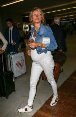 Sylvie Tellier pregnant and Iris Mittenaere arriving at Nice airport during the 71st annual Cannes Film Festival