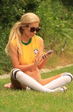 Ana Braga Shows her support for Brazil in just a jersey and a thong
