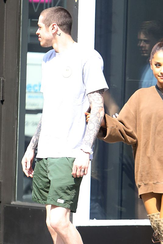 ariana grande and pete davidson hold hands as they go furniture