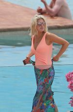 Ashley James In a peach coloured swimsuit as she relaxes by the pool on holiday in Ibiza, Spain