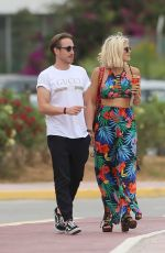 Ashley James Wears a colourful tropical outfit as she steps out with musician Kye Sones on holiday in Ibiza