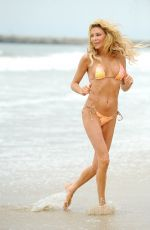 Brandi Glanville On the beach in Santa Monica as she skips in and out of the ocean
