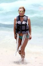 Britney Spears Was pictured riding a jetski to cool down from the Miami heat