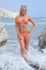 Chloe Crowhurst On a spanish beach during a photoshoot in a bright bikni then attempts hitchhiking home