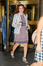Debra Messing Leaving NBC Studios wearing a white pinstripe blazer and holding a coffee in NYC