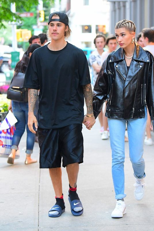 Justin Bieber & Hailey Baldwin hold hands as they leave dinner at Ciprianis in Soho